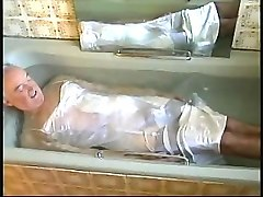 white satin 'nightie' in the bath.
