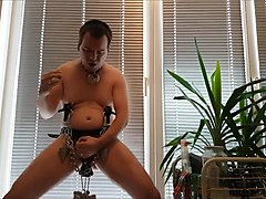 Maso slut toy with ball and nipple weights jerk his cock