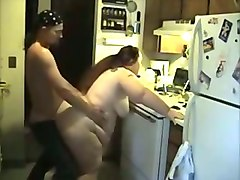 greasy and horny neighbour fucked bad in a doggy position in a kitchen