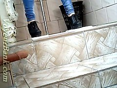 slender girl in very tight blue jeans filmed in the toilet room
