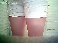 lovely amateur white chick in white shorts urinates in the toilet